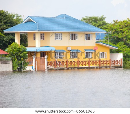 flood waters overtake house in Thailand - stock photo