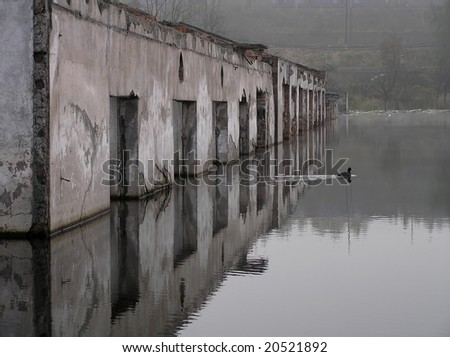 Flooded, abandoned factory - stock photo