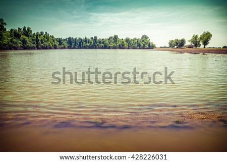 Flooded farmland in rural American after heavy spring rains with vintage filtered effect - stock photo