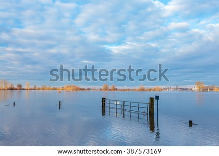 Flooded field in front of the Dutch river IJssel in the province of Gelderland - stock photo
