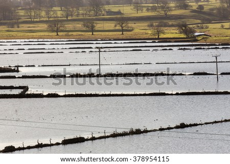 Flooded field, Long Preston in the Yorkshire Dales - stock photo