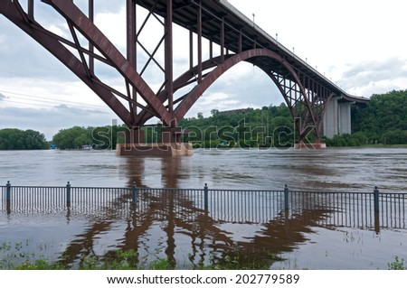 Flooded Mississippi River and High Bridge in Saint Paul Minnesota - stock photo