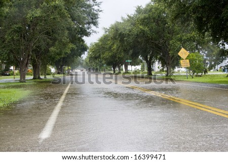 Flooded residential street caused by Tropical Storm Fay located in South Brevard County of Florida - stock photo