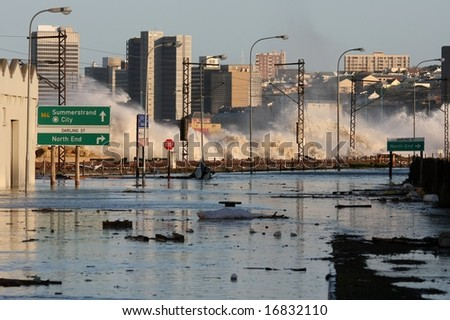 Flooded roadway and railway at a coastal city - stock photo