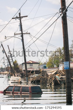 flooded town and vehicles - stock photo