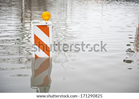 Flooded transportation sign on a cloudy day. - stock photo