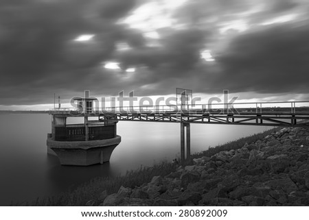 Floodgate in sunset , black and white photography - stock photo