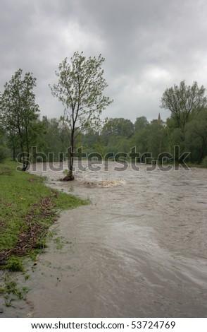 Flooding river Olza in Czech Republic - stock photo