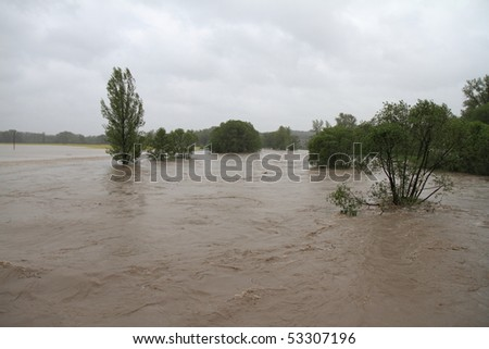 Flooding rivers in north-east of Czech republic. Name of the village - Detmarovice. - stock photo