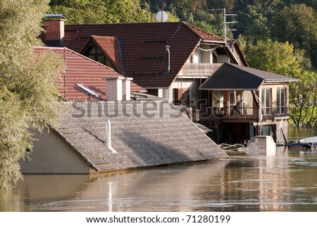 Flooding waters of river Sava and Krka in Slovenia, September 2010 with house under water to the roof. - stock photo
