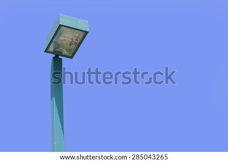 Floodlight tower on blue sky and white cloud - stock photo