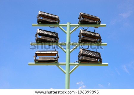 floodlight with metal pole. - stock photo