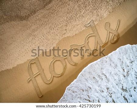Floods written on the beach - stock photo