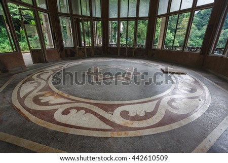 Floor at abandoned Psyrtskha railway station, Abkhazia, summer. - stock photo