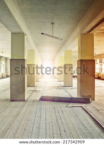 floor bathed in sunlight in an abandoned industrial complex - stock photo