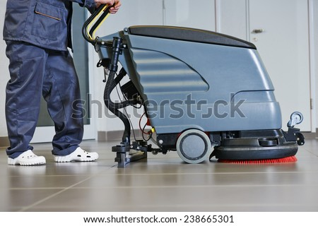 Floor care and cleaning services with washing machine in supermarket shop store - stock photo