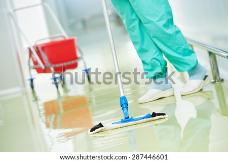 Floor care and cleaning services with washing mop in sterile factory or clean hospital  - stock photo