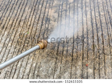 Floor cleaning by pressure water jet  - stock photo