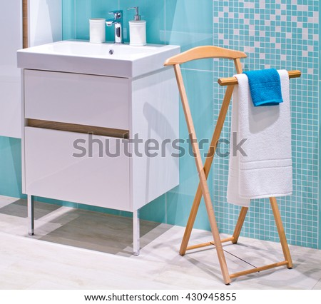 Floor clothes hanger in bathroom, towels drying on a hanger - stock photo