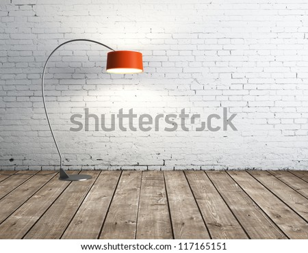 floor lamp in brick room - stock photo