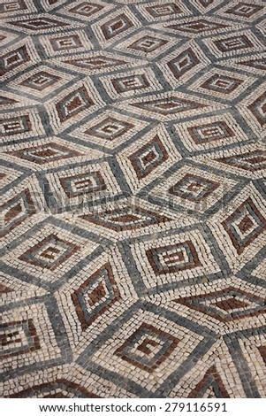 Floor mosaic in the ruins of the ancient Roman city Conimbriga, Portugal - stock photo
