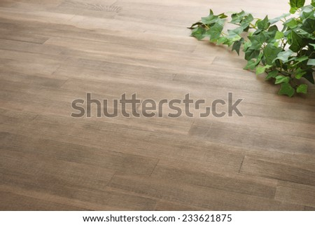 floor texture with green leaf - stock photo