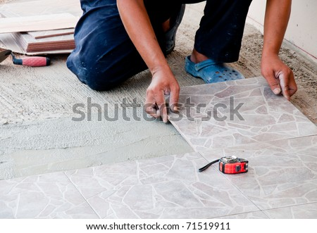 Floor tile installation - stock photo