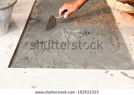 floor tile installation for house building  - stock photo