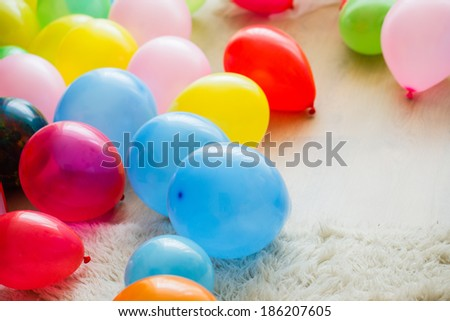 Floor with many colorful balloons on it - stock photo