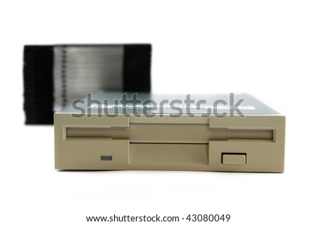 Floppy disk drive isolated on white - stock photo