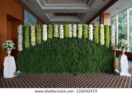 Floral arch of wedding reception for shooting photo of groom and bride with guesses - stock photo