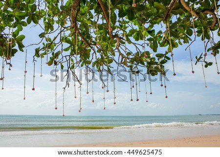 Floral arrangement at a wedding ceremony on beach. - stock photo