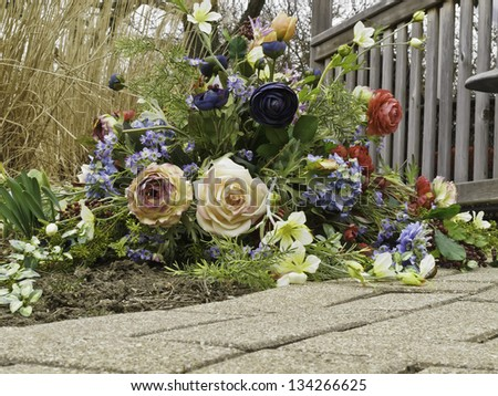 Floral arrangement by gazebo in spring - stock photo