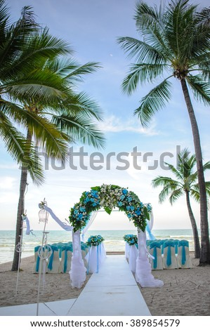 Floral arrangement for backdrop at a wedding ceremony on the beach - stock photo