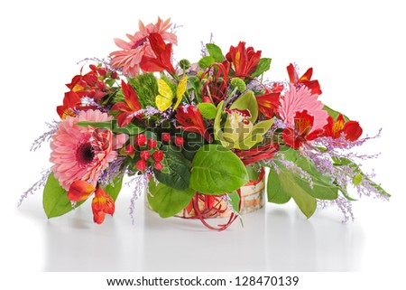 Floral arrangement from lilies, cloves and orchids in cardboard chest on white. - stock photo
