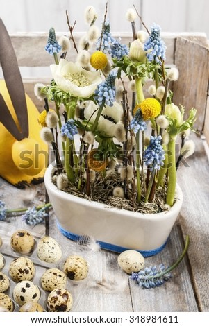 Floral arrangement with anemones and grape hyacinths (blue muscari) - stock photo