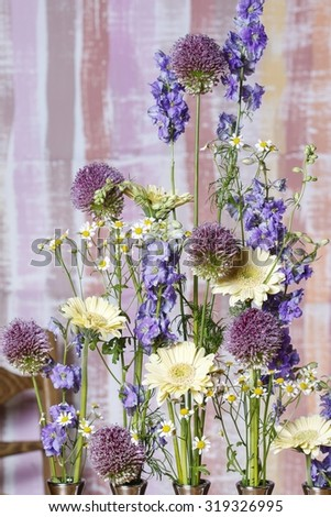 Floral arrangement with delphinium and gerbera flowers - stock photo