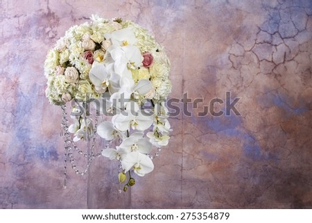Floral arrangement with white orchids, carnations and chrysanthemums. Copy space - stock photo