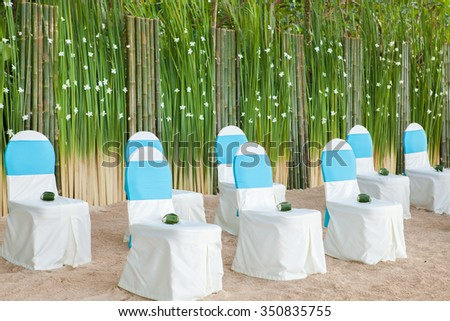 floral arrangements located on seats at a wedding ceremony - stock photo