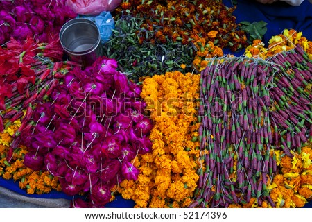 floral arrangment for holi festival and religious offerings in india. - stock photo