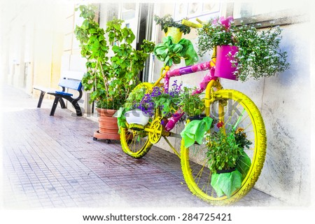 floral bicycle - artistic floral design, street decoration - stock photo