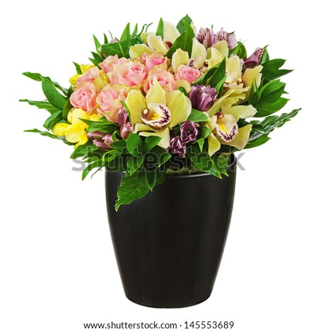 Floral bouquet of roses, lilies and orchids arrangement centerpiece in black vase isolated on white background. Closeup. - stock photo