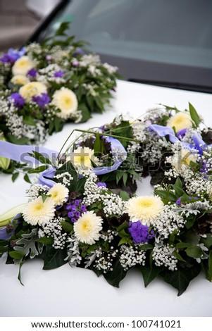 floral decoration on wedding car - stock photo