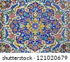 Floral design on the tiled wall of an old mosque in Tehran, Iran. - stock photo