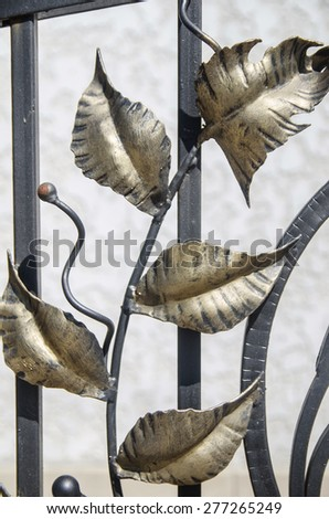 floral ornament on wrought cast iron fence - stock photo