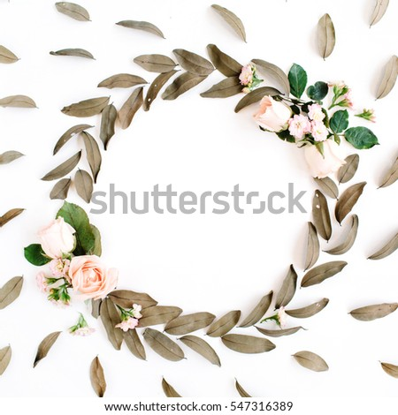 Floral pattern and round frame wreath with roses and dried leaves isolated on white background. Flat lay, top view