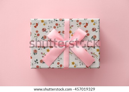 Floral pattern gift box on pink background - stock photo