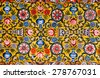 Floral patterns on colorful mural of historical mansion in Rajasthan, India - stock photo