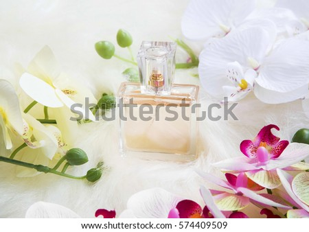 Floral perfume bottle with orchid flowers