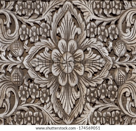 floral tars motifs carved on the old wooden doors. detail - stock photo